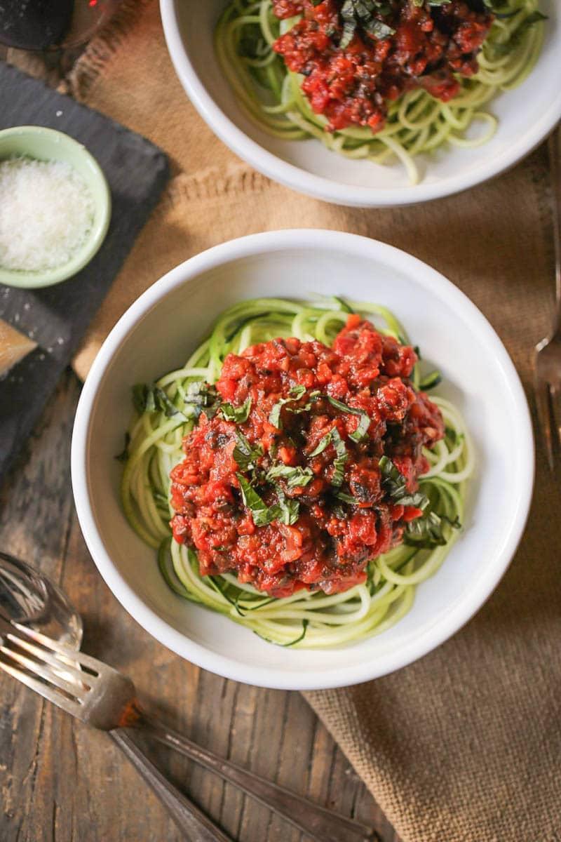 Zucchini Noodles with Portobello Bolognese in bowls.