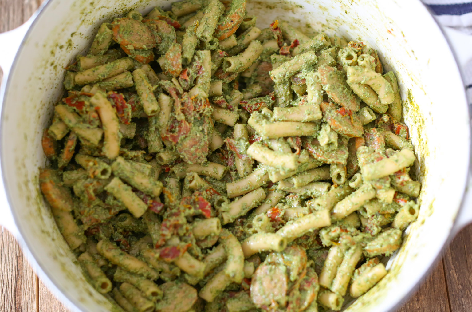 Sausage and Sun-Dried Tomato Pasta with Arugula-Goat Cheese Pesto